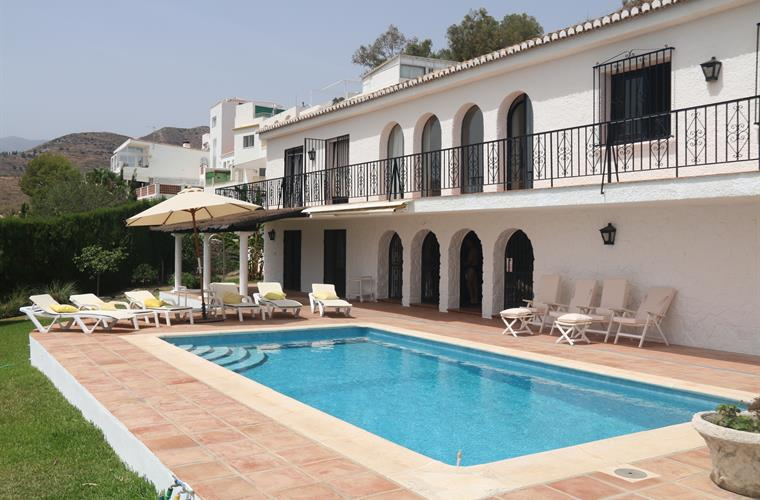 pool terrace with 12 sunbeds  and 4 relaxing chairs