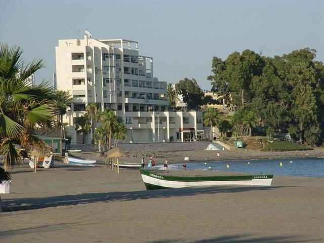 Edificio Jacaranda Estepona with moraga boat on the beach