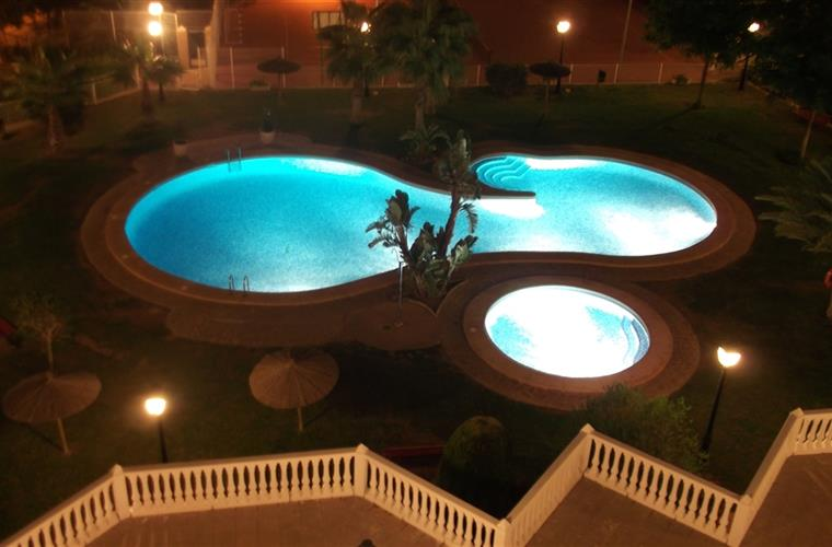 The pool lit for evening swimming