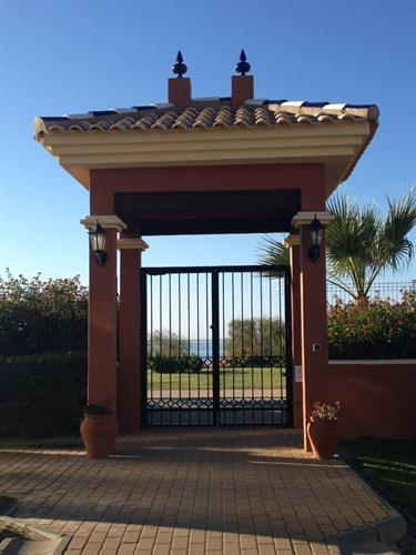 Through this gate and onto the promenade and beach