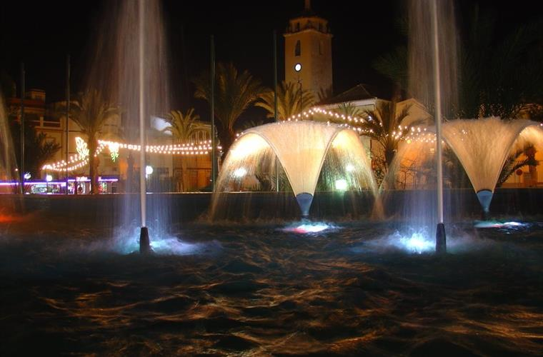 Albox Water Fountain With Church Behind at Night