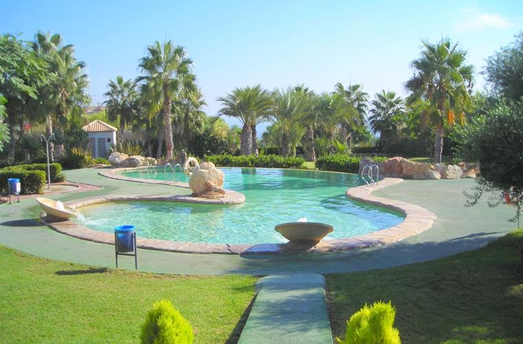 Large communal pool and grounds close by