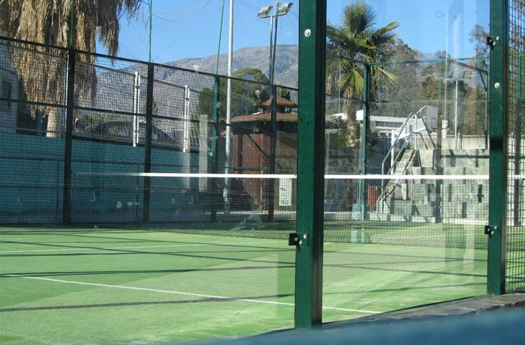 Padel court at rear of the building, small charge for court hire