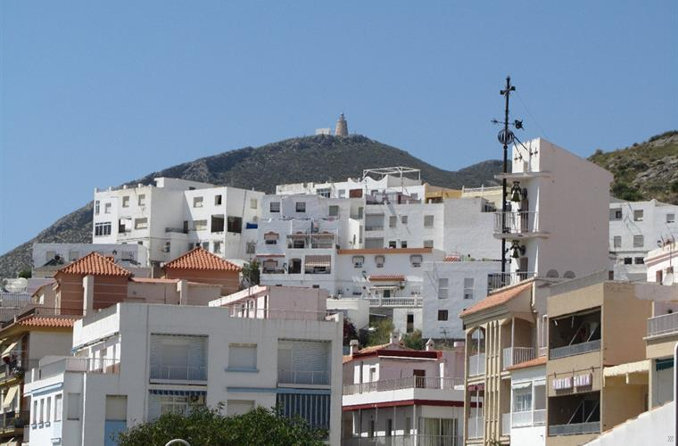 The town of Castell de Ferro with the church and tower.