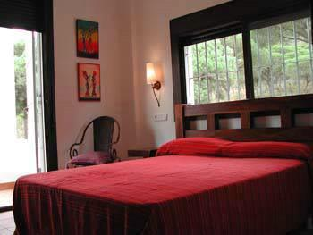 Double Bedroom with views to the Natural Park and private terrace.