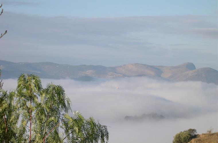 View from Finca del Cielo of Iznajar obscured by cloud