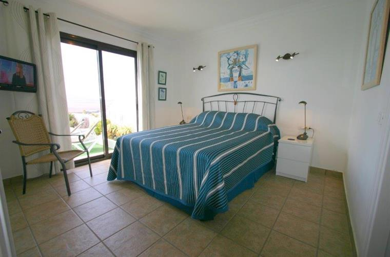 Master bedroom with en-suite and pool/sea views