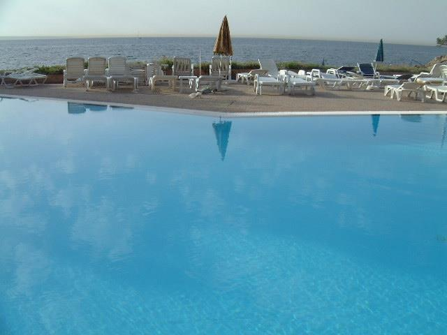 Beachside pool at complex with steps into the sea from the terrace