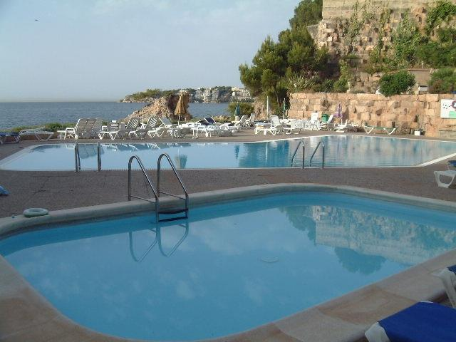 Two pools with direct sea access at complex