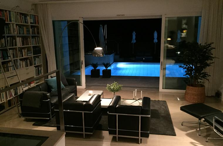 Living room and pool late at night