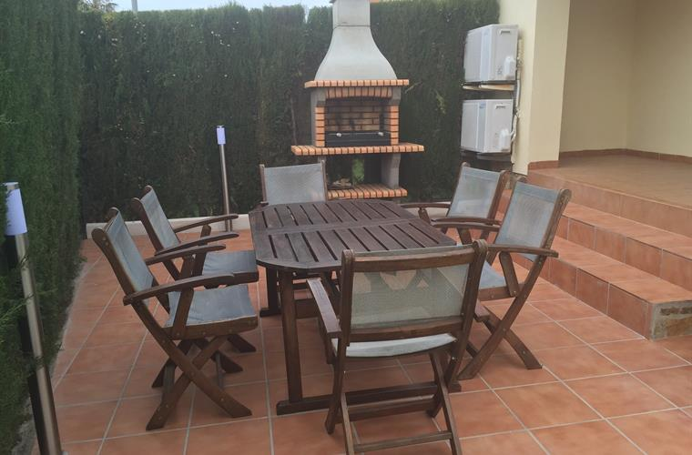Terrace with garden furniture and barbecue