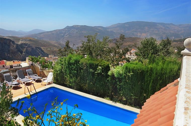 View from the upper terrace to pool and village