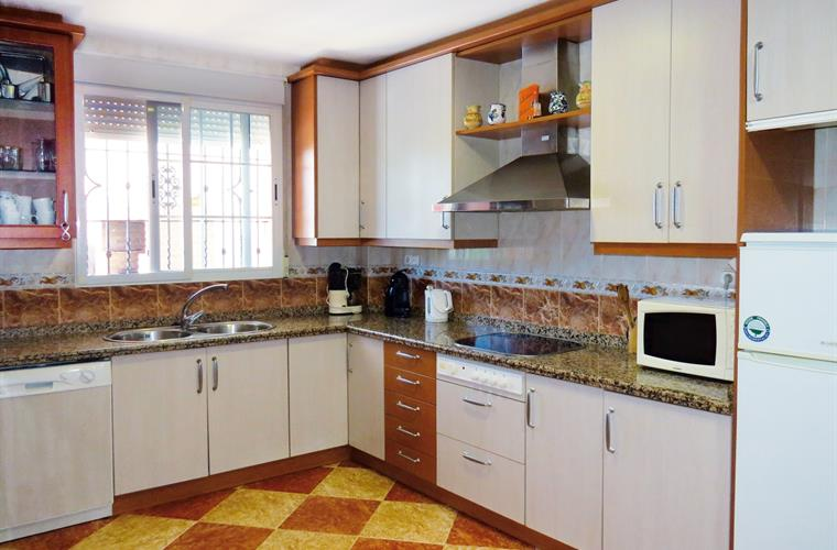 Well equipt kitchen with dishwasher and a small sitting area