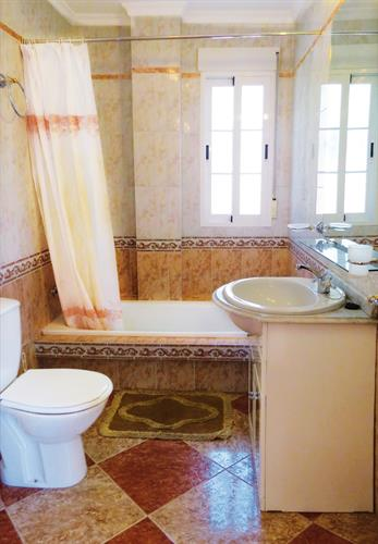 The bigger bathroom with bath tube
