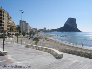 Enjoy a stroll on the promenade beside the beach