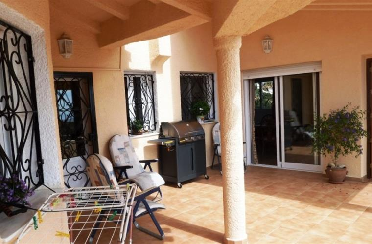 Patio with BBQ Area and lots of comfortable chairs