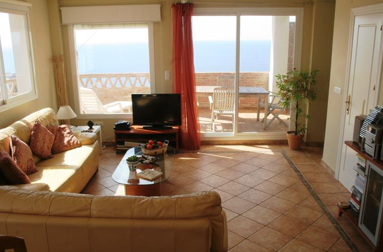 sitting / diner with sea views and access on to the terrace