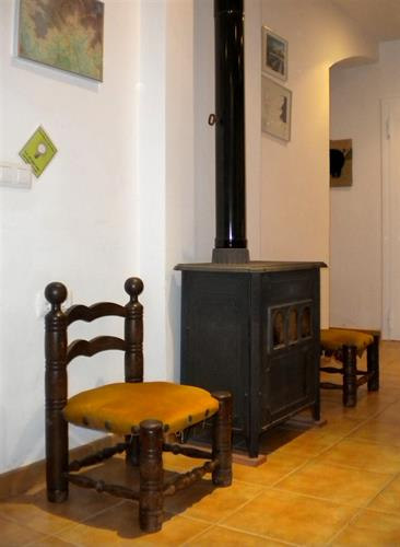 Wood burner by the kitchen.