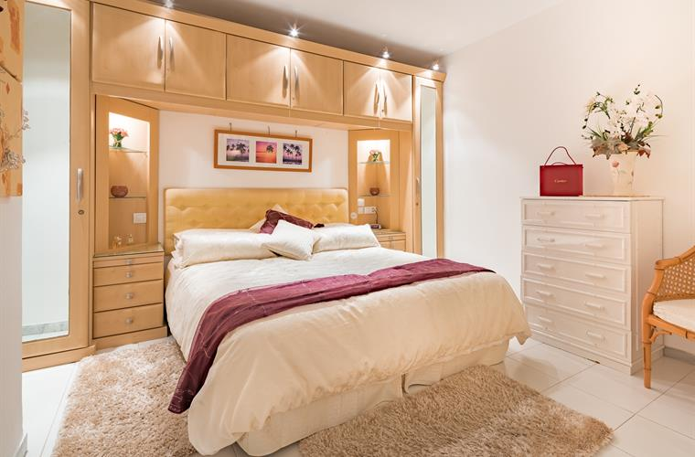 Delightful bedroom with lots of drawers and storage.