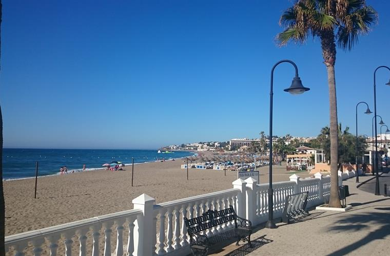 Local La Cala beach with Chiringuitos, sunbeds and watersports