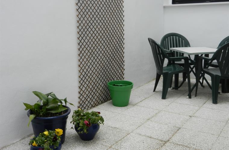 Private Back Terrace with table and chairs