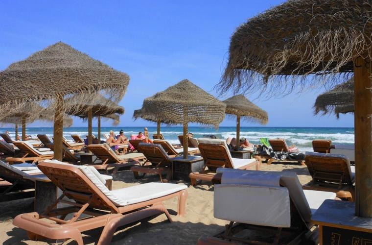 Sunloungers and parasols for hire on the Carabassi beach