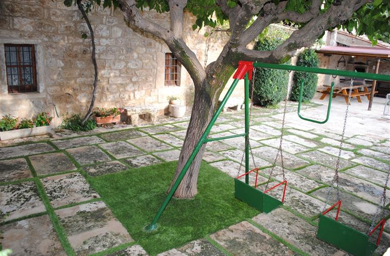 Beautiful garden with swings for children