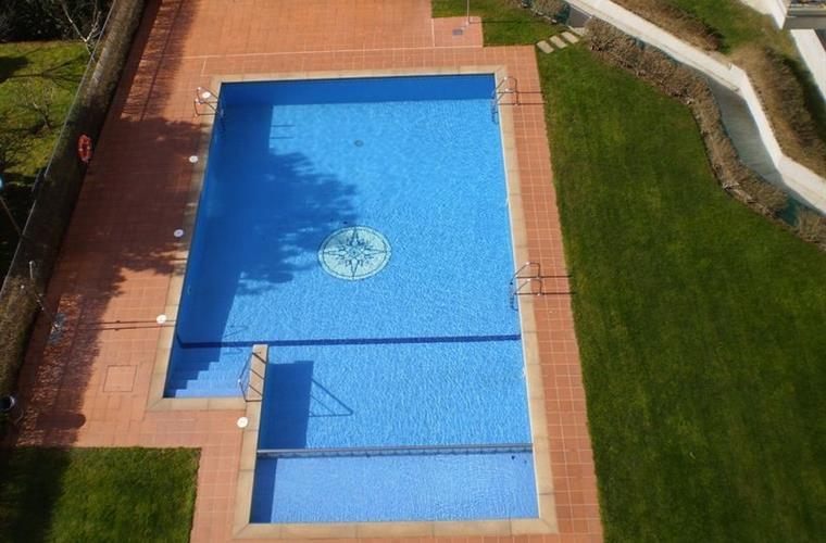 View of the swimming pool from the apartment terrace