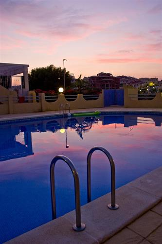 the pool area at sunset