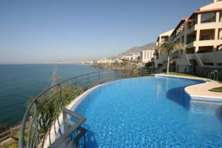 View of apartment and sea from swimming pool