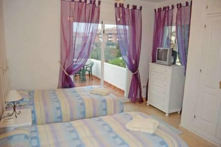 Second bedroom in cool lilac and blue