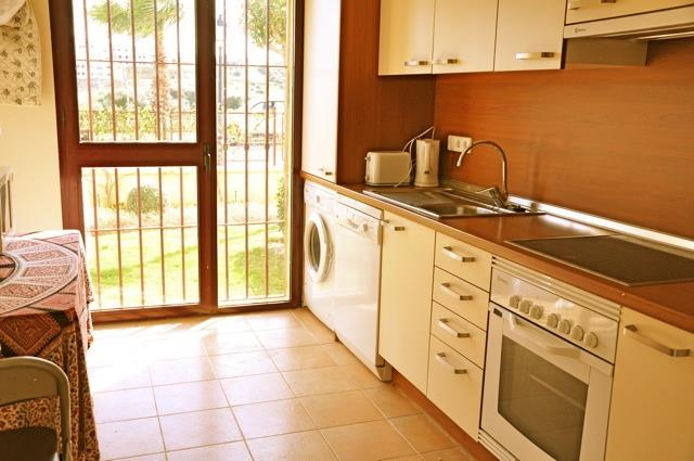 Light and spacious kitchen opening to front garden