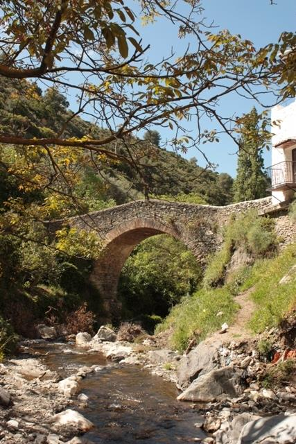 The Roman Bridge leading to the many mountain trails and villages