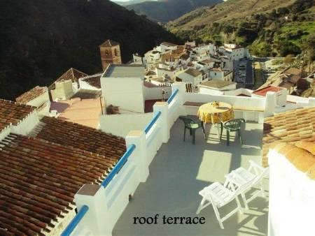 The very large roof terrace overlooks the village