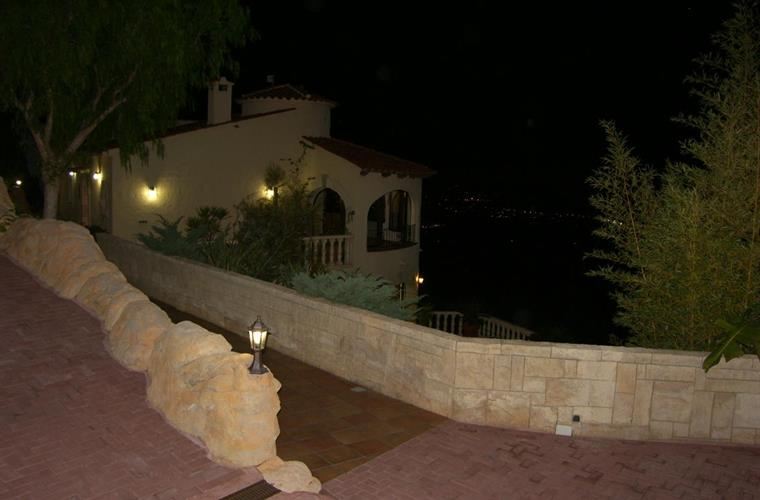 Villa at night viewed from car parking area