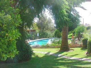 The beautiful gardens and pool of Mi Jardin