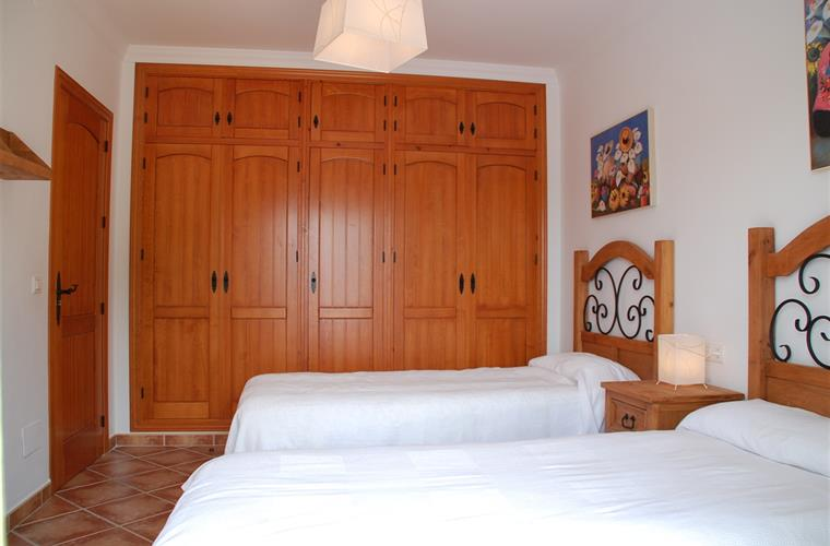 Twin bedroom with access direct to pool terrace.