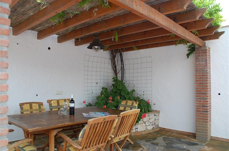 Pergola on swimming pool terrace, ideal for al fresco dining.