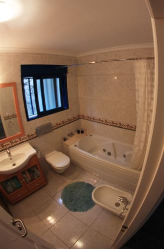 Upstairs bathroom, with bidet, bath and shower over.