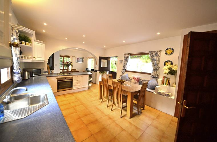 Fully fitted kitchen with stable door leading onto terrace