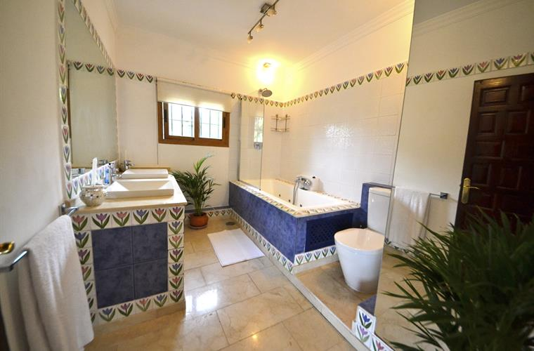 Marbled flooring, twin sinks, handmade Spanish tiles, Power Shower
