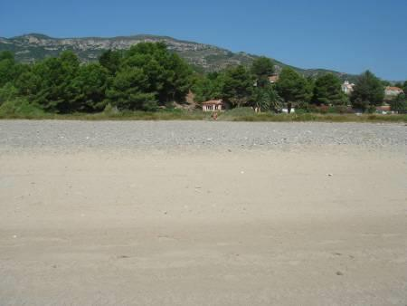 the beach in front of villa