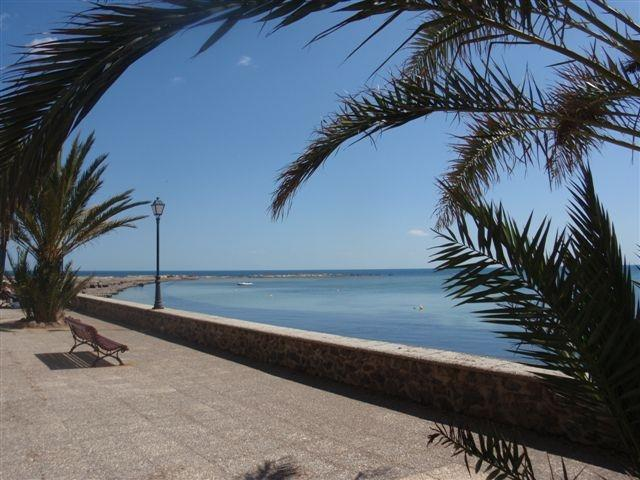 Seaside promenade leading to Mediterranean beach