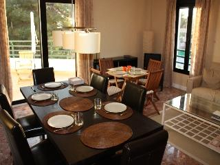 Living room with dining area seats 8 at main table