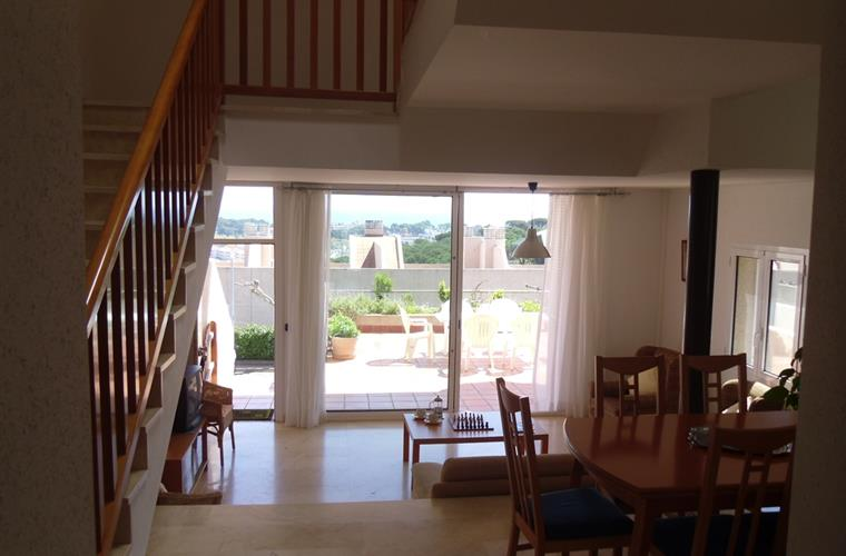 View right through the house to the front terrace and sea views