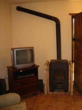 Woodburner and TV unit in lounge