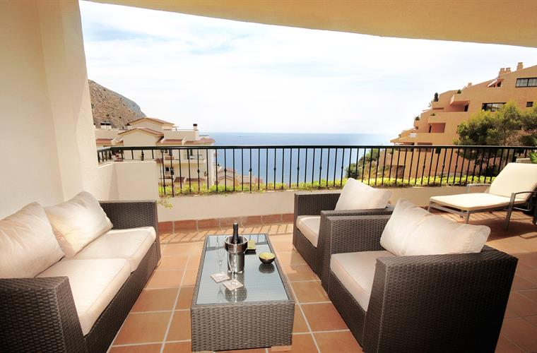 Relaxing on the terrace sofas and overlooking the sea