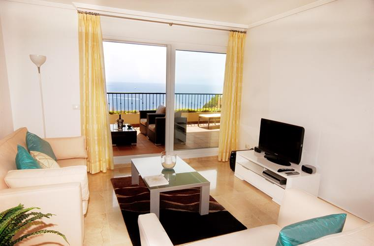 Living room area overlooking sea and with access to sunny terrace