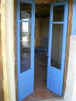 Blue doors lead from lounge to terrace