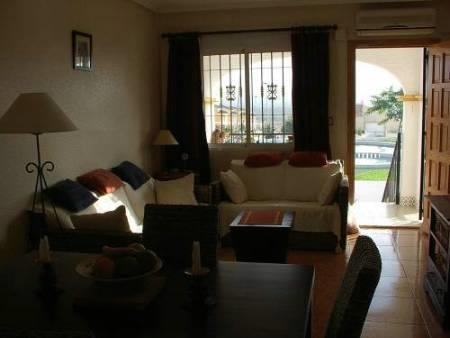 Well furnished lounge/dining room leading to porch. With air-con.